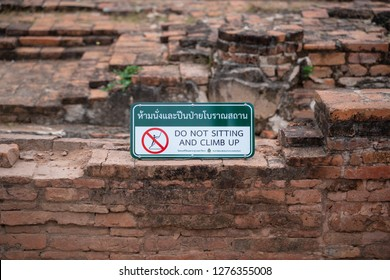PHITSANULOK, THAILAND - JANUARY 6, 2019:  label do not sitting and climb up in Wat Phra Si Rattana Mahathat also colloquially referred to as Wat Yai in Phitsanulok Province,Thailand.
