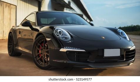 PHITSANULOK, THAILAND - MAY 14, 2016: Motor car Porsche 911 in the street.