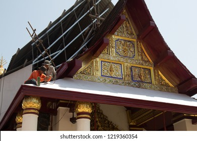 PHITSANULOK, THAILAND - OCT 31, 2018 : Workers repairing Thai temple gable roof, Thai culture construction site. At Wat Phra Sri Rattana Mahatat Woramahawihan, Phitsanulok Thailand.