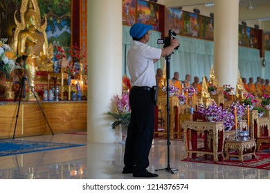 PHITSANULOK, THAILAND - OCTOBER 28, 2018:  Photographer in A traditional Buddhist ceremony, Kathin  in Phitsanulok province, Thailand