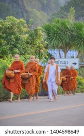 PHITSANULOK, THAILAND-MAY 19: Unidentified buddhist monks and student were leaving alms in the morning on May 19,2019 in Banmung-noenmaprang, Phitsanulok, Thailand