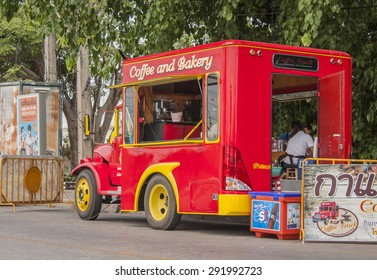 PHITSANULOKE, THAILAND - MAY 3 : Mobile coffee shop (coffee truck) park and service at parking zone in front of Watmahathat temple on May 3 , 2013 at Phitsanuloke Thailand.