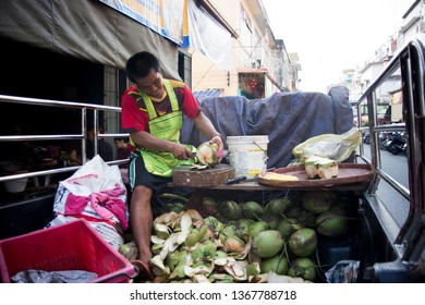 Phitsanulok,Thailand Apil 13,2019 People selling fresh coconut fruits are peeling coconut shells for wholesale in the morning market in Phitsanulok province, Thailand on April 13, 2019.