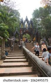 PHNOM KULEN, CAMBODIA - FEB 15, 2015 - Visitors leaving temple at  Phnom Kulen, Cambodia