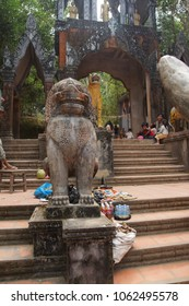 PHNOM KULEN, CAMBODIA - FEB 15, 2015 - Chinth lion statue on the stairway to the Buddhist temple at  Phnom Kulen, Cambodia