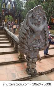 PHNOM KULEN, CAMBODIA - FEB 15, 2015 - Garuda naga statue on the stairway to the Buddhist temple at  Phnom Kulen, Cambodia