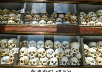 Phnom Penh, Cambodia - 17 January 2018: The skulls of torture victims resting in a stupa at the Killing Fields outside of Phnom Penh, Cambodia.