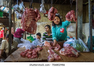 PHNOM PENH, CAMBODIA - AUGUST 11, 2015: A meat vendor waits for customers in the Russian market in Phnom Penh.