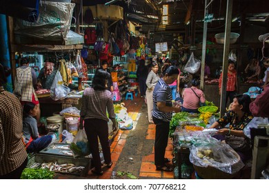 PHNOM PENH, CAMBODIA - AUGUST 11, 2015: Customers browse the varius stalls in the Russian market in Phnom Penh.