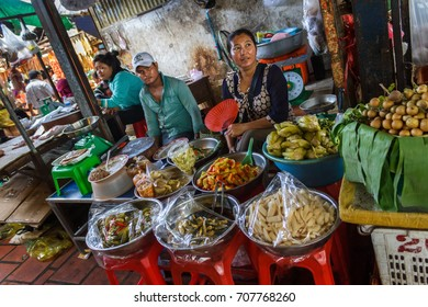 PHNOM PENH, CAMBODIA - AUGUST 11, 2015: Food vendors wait for customers in the Russian market in Phnom Penh.