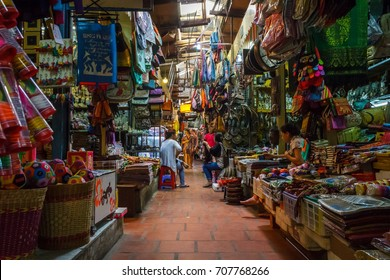PHNOM PENH, CAMBODIA - AUGUST 11, 2015: Several market vendors wait for customers in the Russian market in Phnom Penh.
