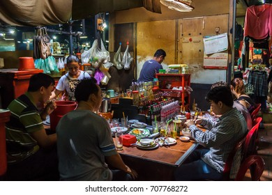PHNOM PENH, CAMBODIA - AUGUST 11, 2015: Customers eat lunch in the Russian market in Phnom Penh.