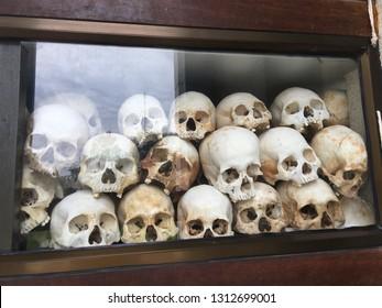 PHNOM PENH,  CAMBODIA - CIRCA NOVEMBER 2018 : Human skulls of victims of the Khmer Rouge at the KILLING FIELD of Choeung Ek.