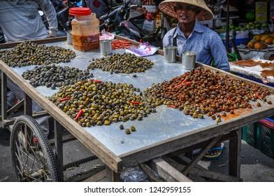PHNOM PENH, CAMBODIA - FEBRUARY 1, 2018: Local people in the market in the capital city of Phnom Penh, Cambodia