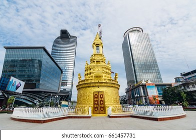 PHNOM PENH, CAMBODIA  - Jan 22, 2017: Gold former buddha stupa and modern skyscrapers on the background at day in Phnom Penh, Cambodia