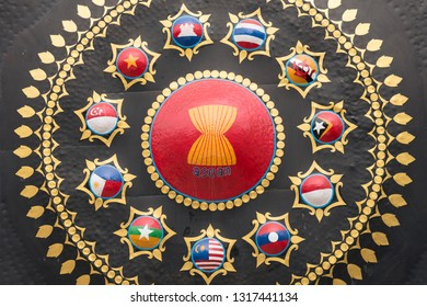 Phnom Penh, Cambodia - January 12, 2019: a closeup of a gong decorated with the emblem of ASEAN and the flags of ASEAN countries in the yard of Wat Ounalom Monastery.