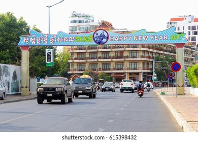 PHNOM PENH, CAMBODIA - March 17. Street sign with Happy New Year 2017 text in English and Khmer language above a traffic street on March 17, 2017 in Phnom Penh. Cambodian New Year on April 14, 2017.