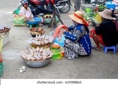PHNOM PENH, CAMBODIA - March 18. Cambodian women is selling fresh fish at the Central Market, Psar Thmei, in the city center on March 18, 2017 in Phnom Penh.