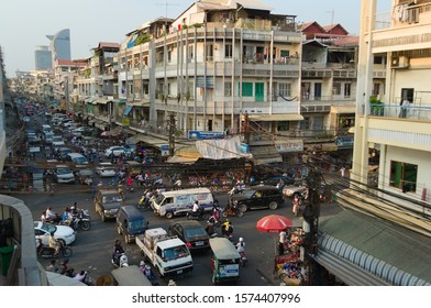 Phnom Penh, Cambodia - March, 2015: Traffic jam on a road intersection. Stuck in a traffic with crowd of motorbikes and car on the crossroad. People driving with no rules on the street.