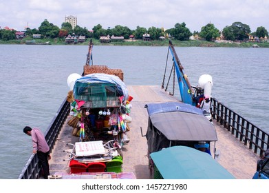 Phnom Penh / Cambodia - May 31 / 2019 : view of a ferry on mekong river loaded by vehicles and passengers