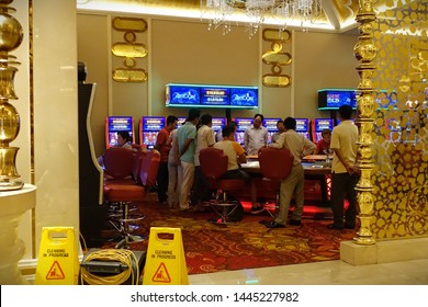 Phnom Penh, Cambodia - May 6, 2019: People gamble in Nagaworld casino. The Cambodian capital is famous for its casinos, attracting gamblers from China and Southeast Asia.