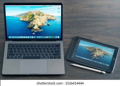 PHNOM PENH, CAMBODIA - October 09,2019 : New features Sidecar on macOS in Macbook pro and iPadOS on iPad2018. Sidecar have Extended desktop, Mirrored desktop features for sharing and presentation.