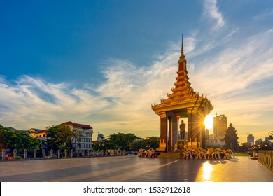PHNOM PENH, CAMBODIA - October 16,2019 : A Statue of King Father Norodom Sihanouk with blue and yellow sky in evening sunset background at central Phnom Penh, Capital of Cambodia.