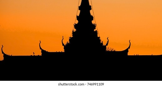 Phnom Penh tourist attraction and famouse landmark - Royal Palace complex on sunset, Cambodia in Silhouette
