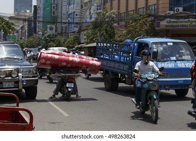 PHNOM PHEN, CAMBODIA - APRIL 25: crazy transport in Phnom Phen, wrong way on April 25, 2014