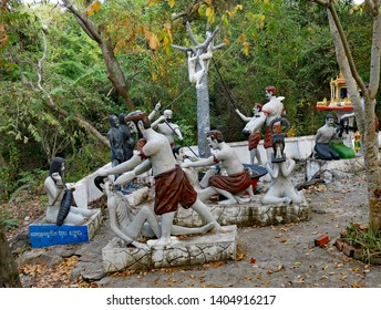 Phnom Sampeau, Battambang, Cambodia 07-12-2018 A scene of horror depicting Naraka, Buddhist Hell. Male and female sculptures in a tableau of agony, torture and torment. Near the Killing Caves.