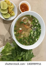 Phnompenh clear rice noodle soup in Vietnamese style (or Hu tieu Nam Vang): Vermicelli noodles is cooked with pork broth and added with topping such as shrimps, offal, cooked pork, squid, & vegetable