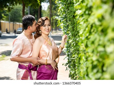 Phnompenh/Cambodia - Feb 1 2019 : The couple Khmer take photo prewedding with wedding dress and Khmer traditional clothes in Royal Palace to prepare their wedding party on next month