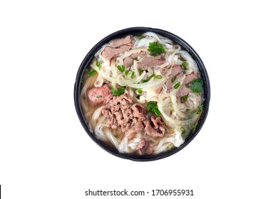 Pho bo with herbs, meat, rice noodles, broth - Pho noodle is traditional Vietnamese soup. Pho is well-know in the World. Isolated on white background.