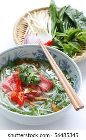 Pho bo , Vietnamese  food , Beef noodle soup with sliced rare beef