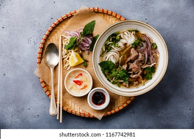 Pho Bo vietnamese Soup with beef in tray on concrete background