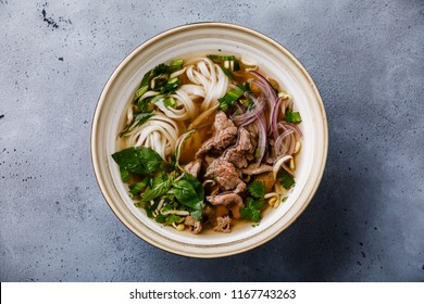 Pho Bo vietnamese Soup with beef in bowl on concrete background