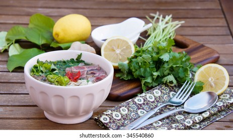 Pho soup -  Vietnamese noodle soup with broth, linguine-shaped rice noodles, cilantro and beef