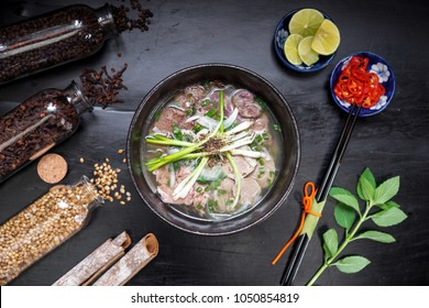Pho Vietnamese Noodle Soup Famous Food on Old Wood. Image for Food Advertise Concept