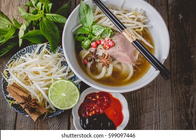Pho Vietnamse Noodle Soup Famous Food on Old Wood. Image for Food Advertise Concept