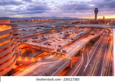Phoenix airport at dawn with light trails in the street.
