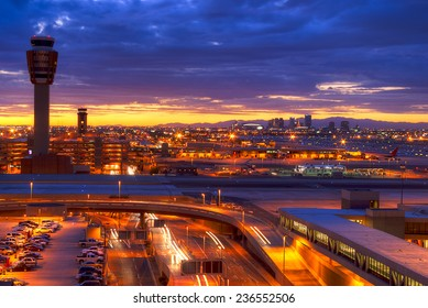 Phoenix airport at sunset with light trails in the street.