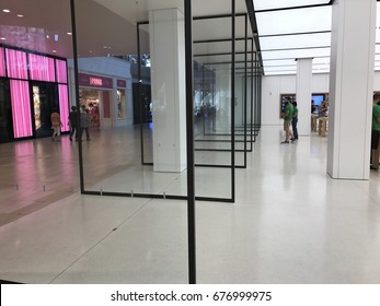 PHOENIX - APRIL 19: Huge pivoting glass doors line the entrance of the newly remodeled Apple retail store located inside of Arrowhead Towne Center shopping mall in Phoenix, Arizona on April 19, 2017.