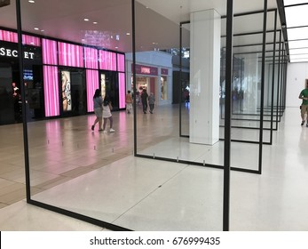 PHOENIX - APRIL 19: Pivoting glass doors line the entrance of the newly remodeled Apple retail store located inside of Arrowhead Towne Center shopping mall in Phoenix, Arizona on April 19, 2017.