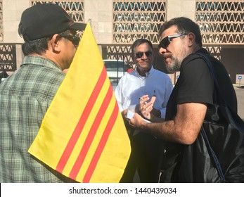 Phoenix, Ariz. / US - August 29, 2018: South Vietnamese emigrant mourners who came to see Sen. John McCain lie in state at the capital talk to a reporter. 6860