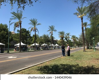 Phoenix, Ariz. / US - August 29, 2018: Under tents to protect against the desert summer heat, mourners line up to see Sen. John McCain lie in state at the capital. 6824