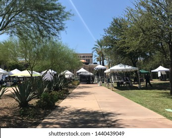 Phoenix, Ariz. / US - August 29, 2018: Under tents to protect against the desert summer heat, mourners line up to see Sen. John McCain lie in state at the capital. 6819