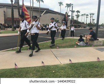 Phoenix, Ariz. / US - August 30, 2018: Mourners gather outside North Phoenix Baptist Church and prepare for a memorial service for Sen. John McCain. 6913