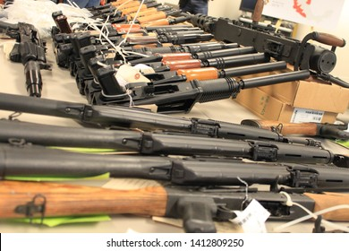 Phoenix, Ariz. / US - January 25, 2011: Guns, handguns, AK-47s and .50 caliber rifles, on display during an announcement about arrests and weapons seizures made during Operation Fast and Furious. 3966