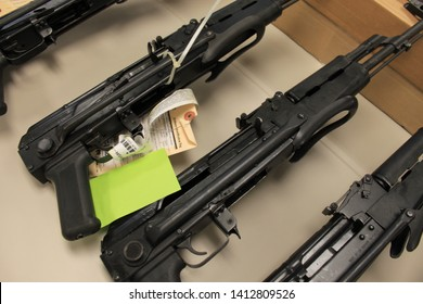 Phoenix, Ariz. / US - January 25, 2011: Guns, handguns, AK-47s and .50 caliber rifles, on display during an announcement about arrests and weapons seizures made during Operation Fast and Furious. 3972