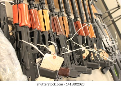 Phoenix, Ariz. / US - January 25, 2011: Guns, handguns, AK-47s and .50 caliber rifles, on display during an announcement about arrests and weapons seizures made during Operation Fast and Furious. 3989
